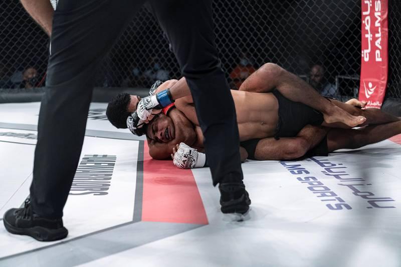 Omar Al Hussaini has Mohamed Sahabdeen held with a rear naked choke in the UAE Warriors 19 Arabia 3 at the Jiu-Jitsu Arena on Friday, June 18, 2021. Courtesy UAE Warriors