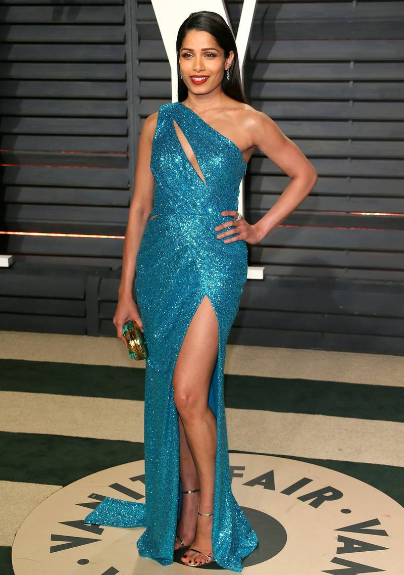 Indian actress Frida Pinto poses as she arrives to the Vanity Fair Party following the 88th Academy Awards at The Wallis Annenberg Center for the Performing Arts in Beverly Hills, California, on February 26, 2017. (Photo by JEAN-BAPTISTE LACROIX / AFP)