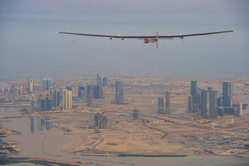 epa04638110 A handout photo made available by the Solar Impulse showing the Solar Impulse 2 during the first test flight in Abu Dhabi, UAE, 26 February 2015. Solar Impulse 2 successfully accomplished the first test flight since the reassembly with the test pilot Markus Scherdel at the controls. Solar Impulse 2, the only solar single-seater airplane able to fly day and night without a drop of fuel, will attempt the First Round-The-World Solar Flight in early March 2015, departing from Abu Dhabi. Swiss founders and pilots, Bertrand Piccard and Andre Borschberg, will take turns flying Solar Impulse 2 over the Arabian Sea, to India, Myanmar, China, then across the Pacific Ocean, to the United States, and over the Atlantic Ocean to Southern Europe or Northern Africa before finishing the journey by returning to the initial departure point.  EPA/JEAN REVILLARD / SOLAR IMPULSE/HAND  HANDOUT EDITORIAL USE ONLY/NO SALES *** Local Caption ***  04638110.jpg 04638110.jpg