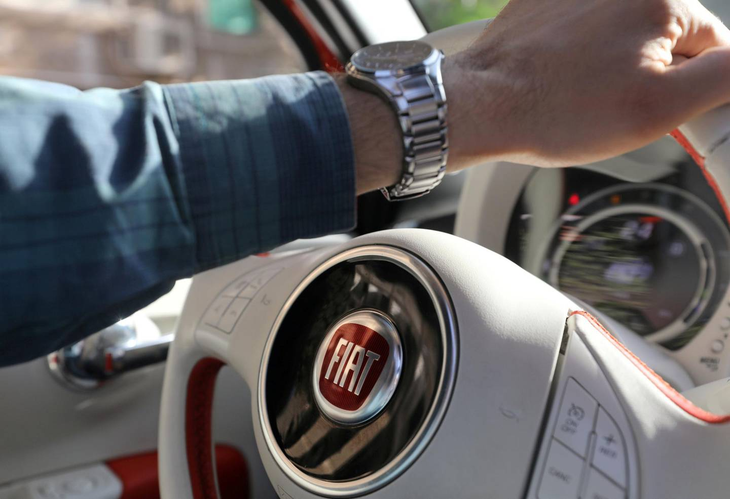 FILE PHOTO: The logo of FIAT carmaker is seen on a steering wheel in Cairo, Egypt, May 19, 2019. Picture taken May 19, 2019. REUTERS/Mohamed Abd El Ghany/File Photo