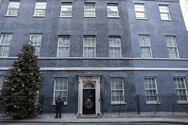 A police officer on patrol at number 10 Downing Street in London, U.K., on Thursday, Dec. 24, 2020. The U.K. and the European Union are on the verge of unveiling a historic post-Brexit trade accord as negotiators work through the night to put the finishing touches to a compromise on fishing rights. Photographer: Jason Alden/Bloomberg