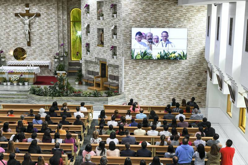 Abu Dhabi, United Arab Emirates - Worshippers view the historic Papal mass at St. JosephÕs Cathedral on February 5, 2019. Khushnum Bhandari for The National