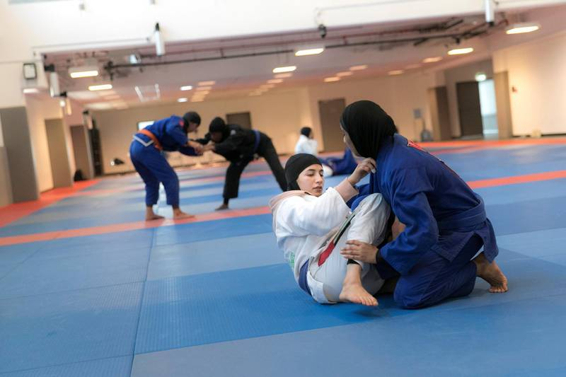 ABU DHABI, UNITED ARAB EMIRATES - AUGUST 14, 2018. Mahra Al Hanaei, in white, of the UAE Jiu Jitsu national team, trains for the Asian Games 2018.(Photo by Reem Mohammed/The National)Reporter: AMITH PASSATHSection:  SP