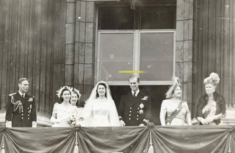 Members of the British royal family on the balcony at Buckingham Palace after the wedding of Princess Elizabeth and Philip Mountbatten (later Queen Elizabeth II and Prince Philip, Duke of Edinburgh), London, 20th November 1947. Left to right: King George VI, Princess Margaret, Lady Mary Cambridge, Elizabeth, Philip, Queen Elizabeth (later Queen Mother) and Queen Mary. (Photo by Evening Standard/Hulton Archive/Getty Images)
