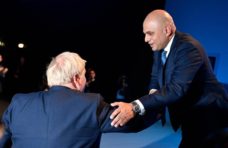 epa09304118 (FILE) - Britain's then Chancellor of the Exchequer Sajid Javid (R) is thanked by Prime Minister Boris Johnson (L) after he delivers a speech at the Conservative Party Conference in Manchester, Britain, 30 September 2019 (reissued 26 June 2021). Downing Street on 26 June 2021 said Sajid Javid was appointed to succeed Matt Hancock who resigned as Health Secretary.  EPA/NEIL HALL *** Local Caption *** 55509051