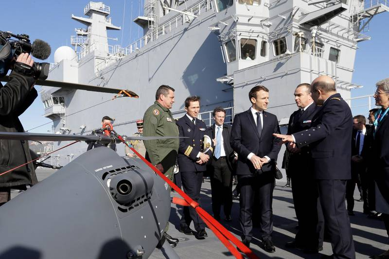 French President Emmanuel Macron attends the presentation of drone on the deck of the French war ship Dixmude docked in the French Navy base of Toulon, southern France, after delivering a speech to present his New Year's wishes to the French Army, January 19, 2018. REUTERS/Claude Paris/Pool