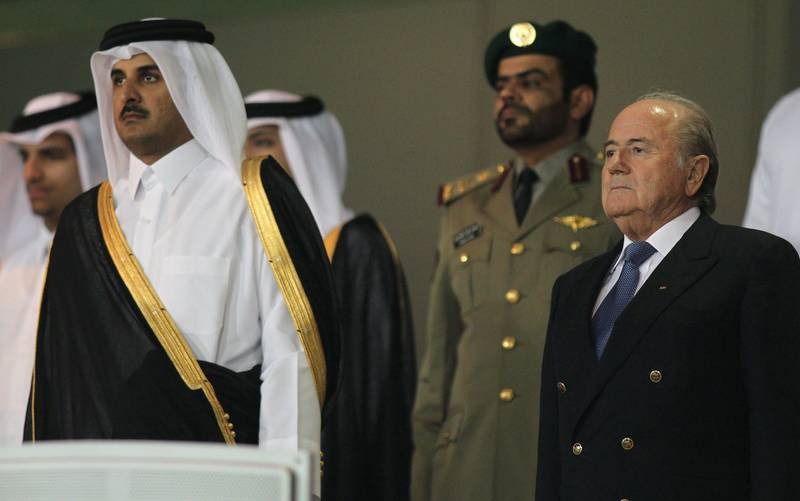 Qatar's Crown Prince Sheikh Tamim bin Hamad al-Thani (L) and FIFA president Sepp Blatter (R) attend the final match of the Crown Prince Cup football tournament between Qatari teams Al-Arabi and Al-Gharrafa in Doha on April 24, 2010. Al-Gharrafa won the match 5-0. AFP PHOTO/KARIM JAAFAR *** Local Caption ***  377001-01-08.jpg