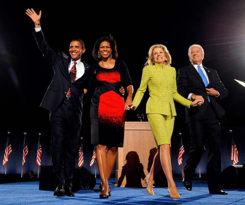 """(FILES) In this file photo taken on November 04, 2008, US President-elect Barack Obama (L), his wife Michelle (2ndL), vice president-elect Joe Biden (R) and his wife Jill arrive for an election night party in Chicago, Illinois. Jill Biden is no stranger to the glare of the political spotlight. Her husband has been a Washington insider since they wed in 1977, and she was America's second lady for eight years. But if Joe Biden wins the White House, his 69-year-old wife will have the opportunity to push the role of first lady into the 21st century -- by keeping her full-time job as a professor. """"Most American women have both a work life and a family life, but first ladies have never been allowed to do so,"""" said Katherine Jellison, a history professor at Ohio University. / AFP / Emmanuel DUNAND"""