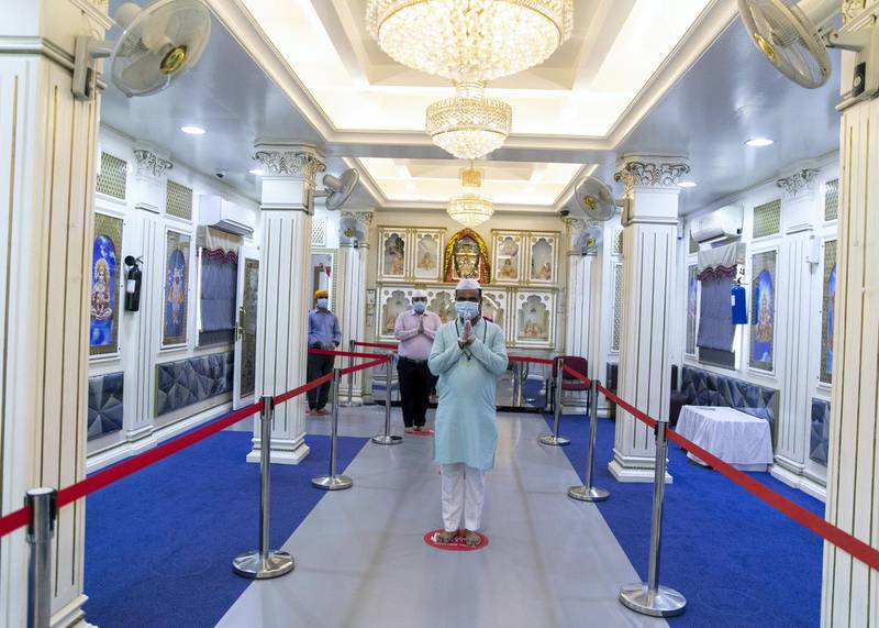 """DUBAI, UNITED ARAB EMIRATES. 30 JUNE 2020. Shiva temple in Dubai.Hindu temples and a Sikh gurdwara in Dubai are also ready to open without ritual ceremonies and offerings to the gods.Trustees await details from the CDA about the restricted timing during which worshippers could enter to pray.Gatherings inside the shrine, rituals or pujas, flowers and food offerings to the gods will not be permitted and entry is likely for a few hours in the morning and evening.""""There will no sit-down prayers, no reading of holy books inside,"""" said Raju Shroff, a trustee of the Hindu temples in Bur Dubai.""""People can come in to pray and must leave. They cannot mingle inside, there will no prasad (offering), aarti (religious rituals) will not be open to the public. We are ready and officials have come in and checked the precautions in place as people walk around the temple.""""The shrines have been inspected by officials from the CDA, police and Ncema officials over the past week.Regular deep cleaning, thermal scanners at the entrance and individual temperature checks are among safety measures.The two Bur Dubai temples usually attract between 3,000 to 5,000 people daily and about 15,000 over the weekend.Separators have been placed inside the temple to manage the flow of people.The gradual opening up of places of worship has been welcomed.(Photo: Reem Mohammed/The National)Reporter:Section:"""