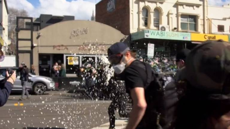An image that illustrates this article Footage goes viral after Melbourne police use pepper spray on anti-lockdown protesters