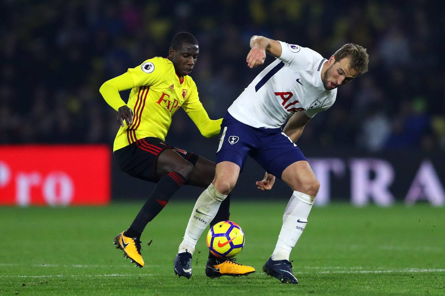 WATFORD, ENGLAND - DECEMBER 02: Harry Kane of Tottenham Hotspur is challenged by Abdoulaye Doucoure of Watford during the Premier League match between Watford and Tottenham Hotspur at Vicarage Road on December 2, 2017 in Watford, England.  (Photo by Warren Little/Getty Images)