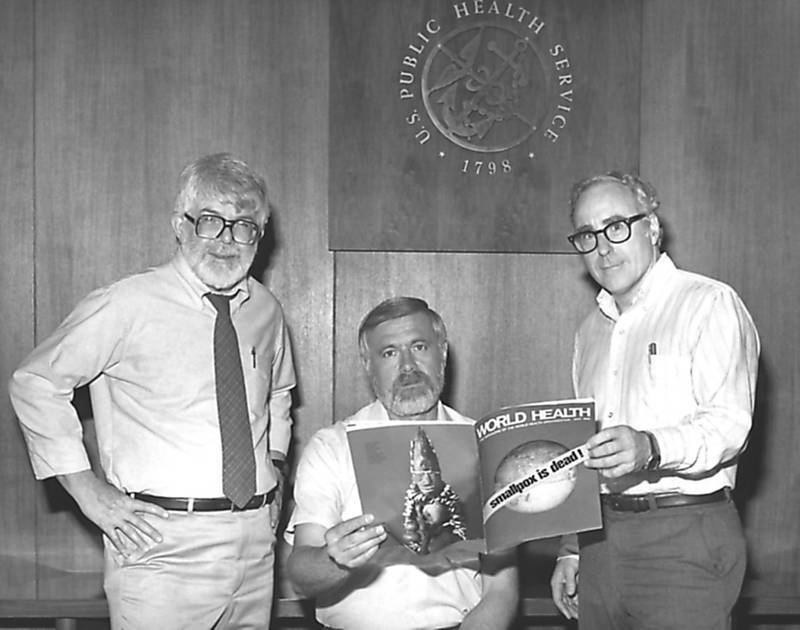 FOR MALARIA / SMALPOX GALLERY. Three former directors of the Global Smallpox Eradication Program, Dr J. Donald Millar, Dr William H. Foege and Dr J. Michael Lane, holding world Health magazine, 1980. Image courtesy Centers for Disease Control (CDC). (Photo by Smith Collection/Gado/Getty Images)