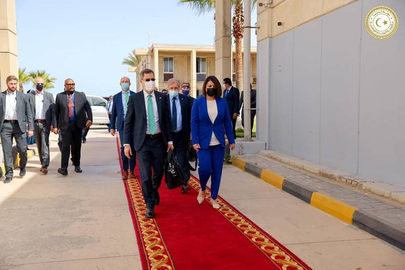 US Acting Assistant Secretary of State for Near Eastern Affairs Joey Hood walks with Libyan Foreign Minister Najla el-Mangoush upon his arrival, in Tripoli, Libya May 18, 2021. Media Office of the Prime Minister/Handout via REUTERS ATTENTION EDITORS - THIS IMAGE HAS BEEN SUPPLIED BY A THIRD PARTY.