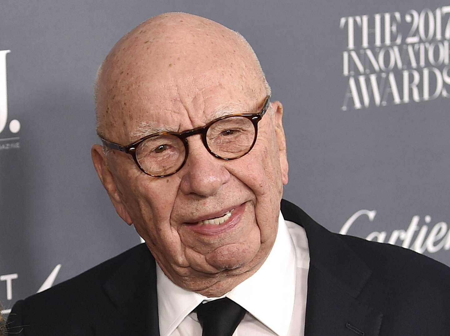 FILE - In this Wednesday, Nov. 1, 2017, file photo, Fox News chairman and CEO Rupert Murdoch attends the WSJ. Magazine 2017 Innovator Awards at The Museum of Modern Art in New York. Murdoch has told senior managers at 21st Century Fox that he will be working from home for a few weeks after a recent back injury in a sailing accident. (Photo by Evan Agostini/Invision/AP, File)