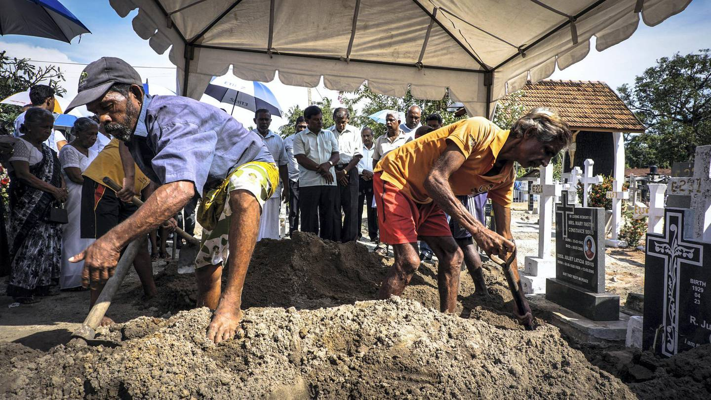 Grave diggers bury a victim of the suicide bomb attacks in Negombo, Sri Lanka, April 23, 2019. Jack Moore / The National.