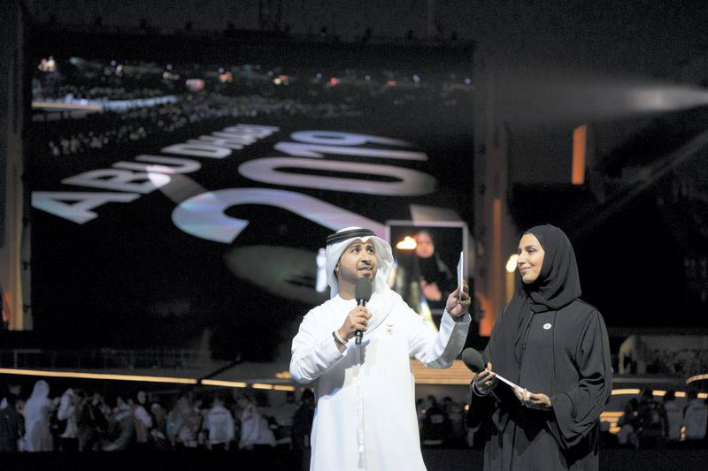ABU DHABI, UNITED ARAB EMIRATES - March 21, 2019: Faisal Bin Huraiz (L) and Mariam Al Amiri (R) present during the closing ceremony of the Special Olympics World Games Abu Dhabi 2019, at Zayed Sports City.   ( Hamad Al Mansoori for Ministry of Presidential Affairs ) ---