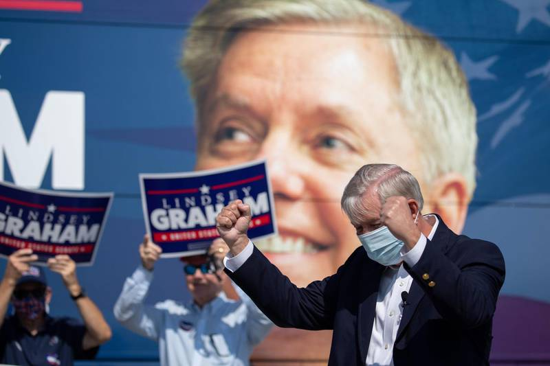 (FILES) In this file photo taken on October 16, 2020 US Senator Lindsey Graham arrives to address supporters for a get out the vote rally at the Charleston Coliseum and Convention Center in North Charleston, South Carolina.  US Senator Lindsey Graham of South Carolina won reelection on November 3, 2020, US media reported. / AFP / Logan Cyrus