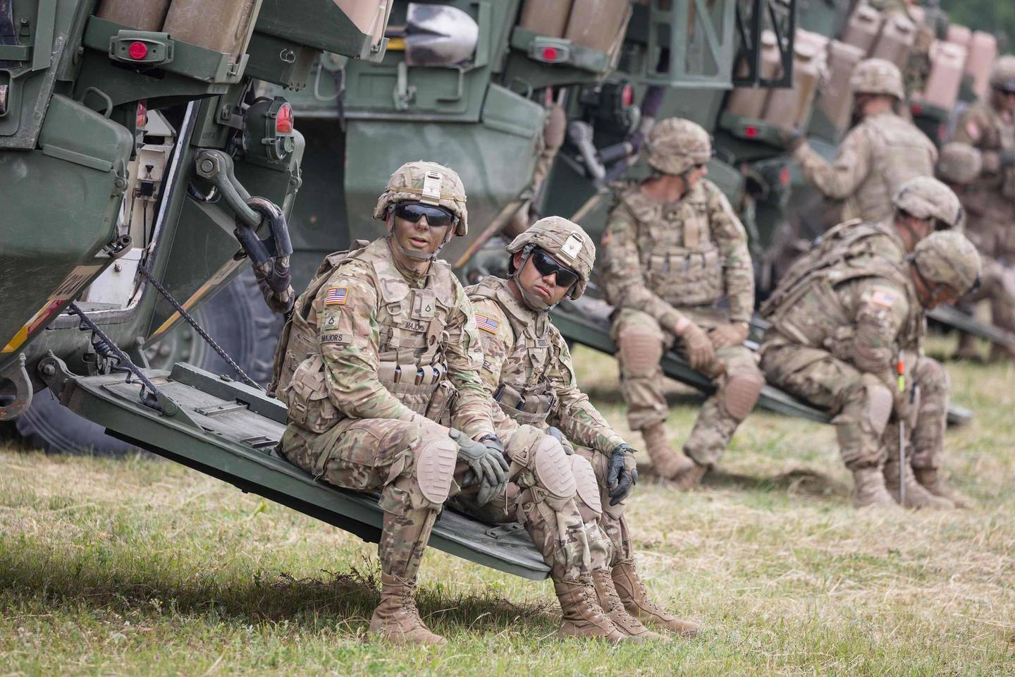 (FILES) In this file photo taken on June 16, 2017 US Soldiers are seen during NATO Saber Strike military exercises  in Orzysz, Poland.  Poland hopes to receive more US troops, Prime Minister Mateusz Morawiecki said on June 6, 2020, after the Wall Street Journal reported that Washington plans to slash its military presence in Germany. / AFP / -