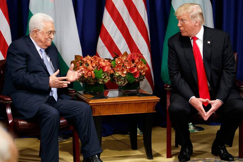 President Donald Trump meets with Palestinian President Mahmoud Abbas at the Palace Hotel during the United Nations General Assembly, Wednesday, Sept. 20, 2017, in New York. (AP Photo/Evan Vucci)
