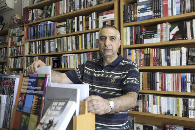 """""""It will be a good sign to see him in prison. So many Palestinians will be happy,"""" says Imad Muna, owner of the Educational Bookshop on Salah al-Din Street, occupied East Jerusalem's main thoroughfare.It is hard to find a Palestinian who feels sorry for Benjamin Netanyahu as corruption investigations close in on him and threaten his continued tenure as prime minister.(Photo by Heidi Levine for The National )."""