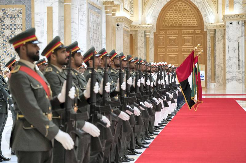 ABU DHABI, UNITED ARAB EMIRATES - July 24, 2018: The UAE honor guard stand to attention during a reception for HE Dr Abiy Ahmed, Prime Minister of Ethiopia (not shown) and HE Isaias Afwerki, President of Eritrea (not shown), at the Presidential Palace.   ( Mohamed Al Hammadi / Crown Prince Court - Abu Dhabi ) ---