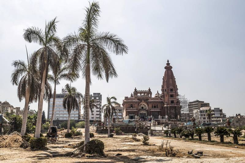 """This picture taken on August 18, 2019 shows restoration works ongoing at the historic """"Le Palais Hindou"""" (also known as the """"Baron Empain Palace"""") built by in the early 20th century by Belgian industrialist Edouard Louis Joseph, Baron Empain, in the classical Khmer architectural style of Cambodia's Angkor Wat, in the Egyptian capital Cairo's northeastern Heliopolis district. (Photo by Khaled DESOUKI / AFP)"""
