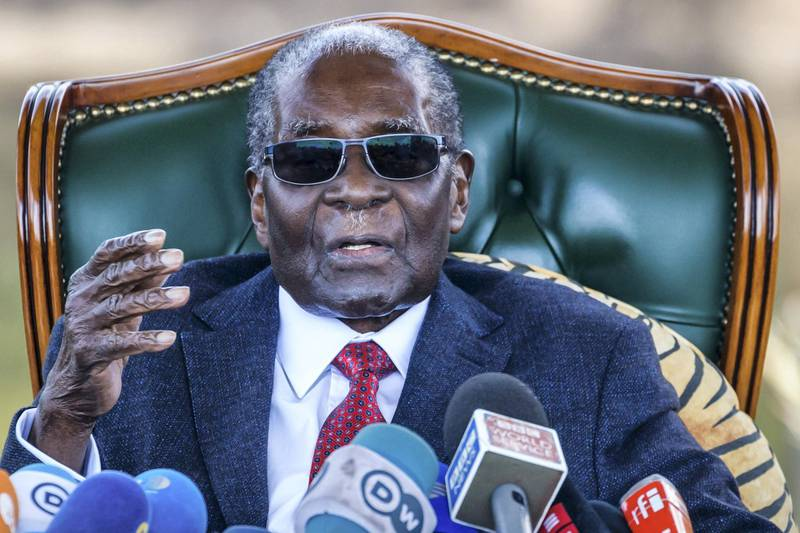 (FILES) In this file photo taken on November 17, 2017, Zimbabwe's then President Robert Mugabe delivers a speech during a graduation ceremony at the Zimbabwe Open University in Harare, where he presides as the Chancellor. - Zimbabwe ex-president Robert Mugabe has died aged 95 according to official on September 6, 2019. (Photo by Jekesai NJIKIZANA / AFP)