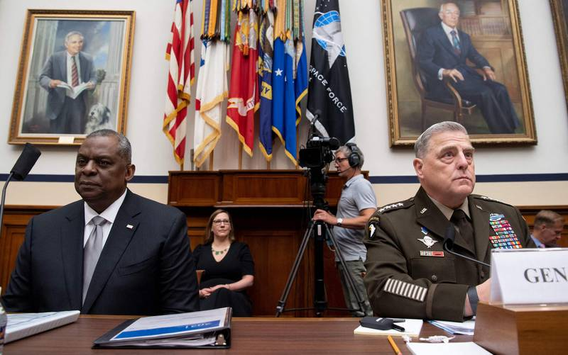 General Mark Milley (R), Chairman of the Joint Chiefs of Staff, and US Secretary of Defense Lloyd Austin III (L) testifies on the department's fiscal year 2022 budget request during a House Armed Services Committee hearing on Capitol Hill in Washington, DC, on June 23, 2021. / AFP / SAUL LOEB