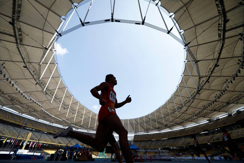Cambodia's Nget Phearath competes during the Men's 400-meter semi-final 2 at the 29th South East Asian Games in Kuala Lumpur, Malaysia, Thursday, Aug. 24, 2017. (AP Photo/Vincent Thian)