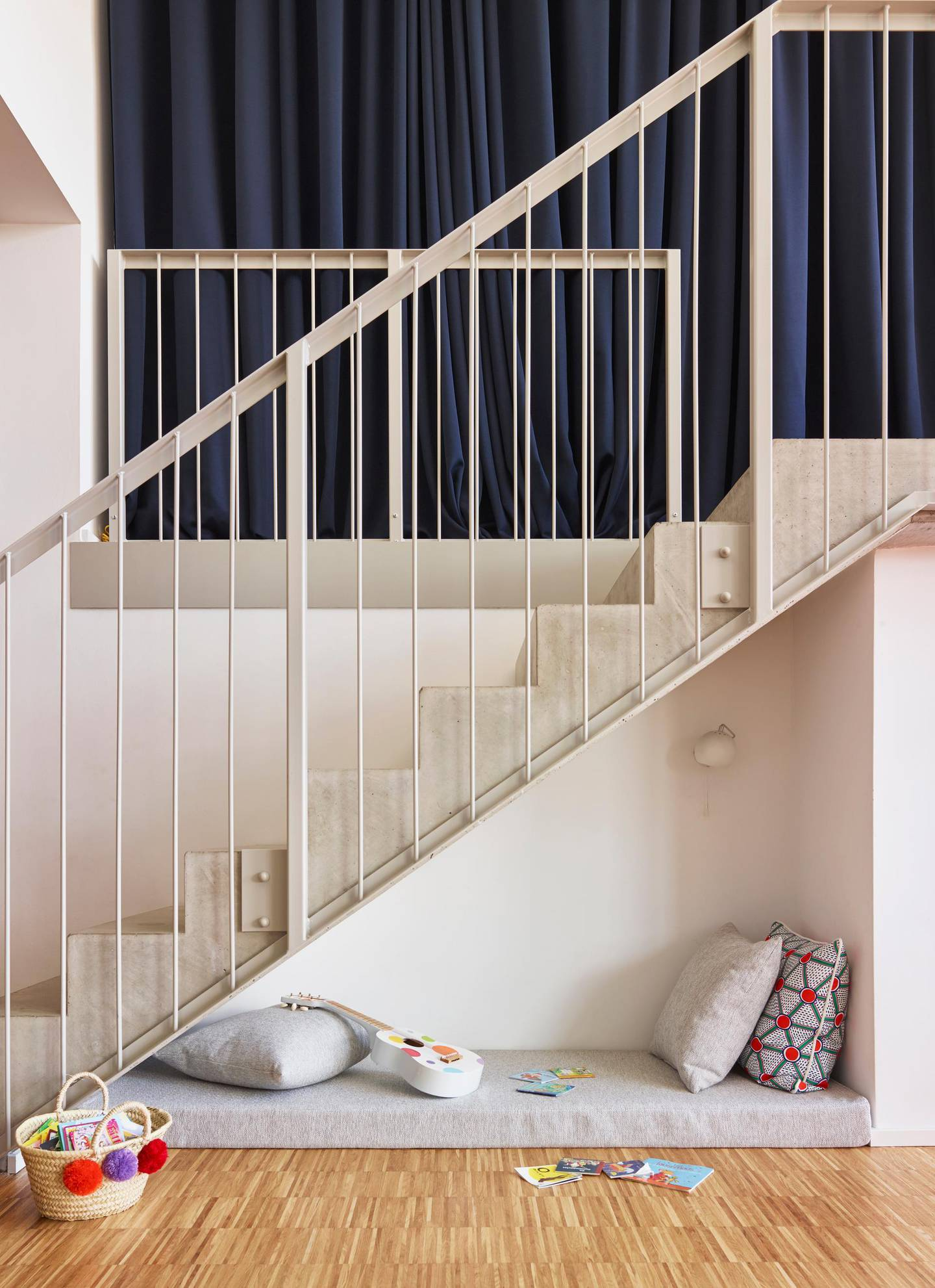 Cushions and toy guitar under steps at home. Getty Images