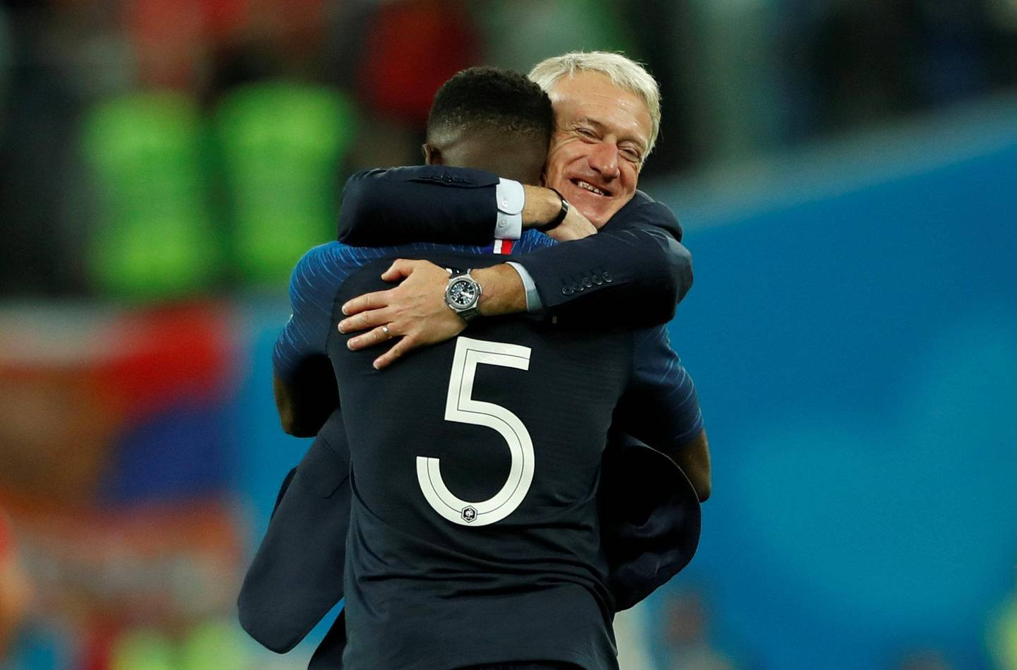 Soccer Football - World Cup - Semi Final - France v Belgium - Saint Petersburg Stadium, Saint Petersburg, Russia - July 10, 2018  France coach Didier Deschamps celebrates with Samuel Umtiti at the end of the match   REUTERS/Lee Smith