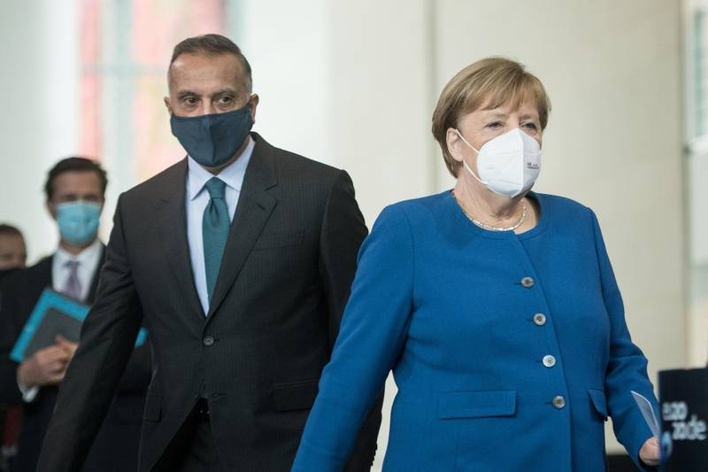 German Chancellor Angela Merkel and Iraqi Prime Minister Mustafa al-Kadhimi arrive for a news conference at the Chancellery in Berlin, Germany October 20, 2020. Stefanie Loos/Pool via REUTERS