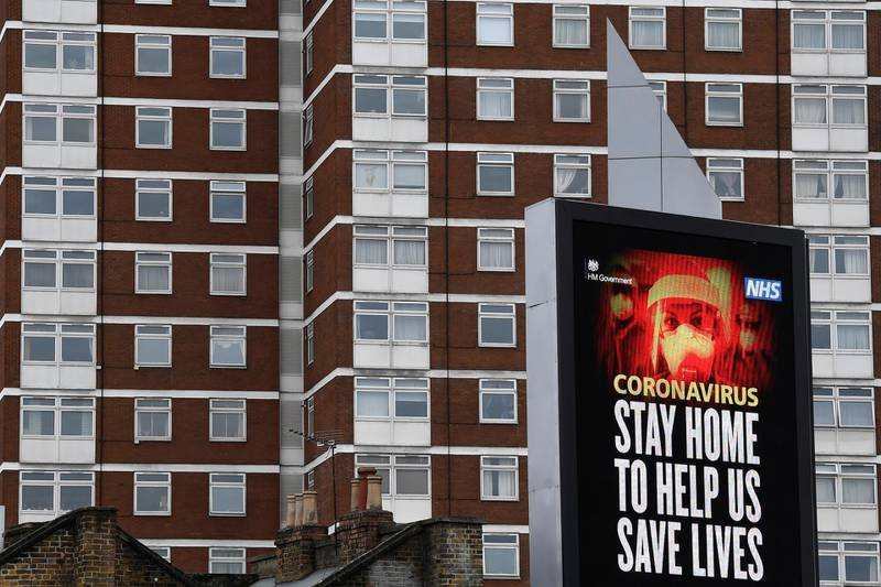 A UK government public health campaign message is displayed on a billboard in West London, as the spread of the coronavirus disease (COVID-19) continues, London, Britain, April 1, 2020. REUTERS/Toby Melville
