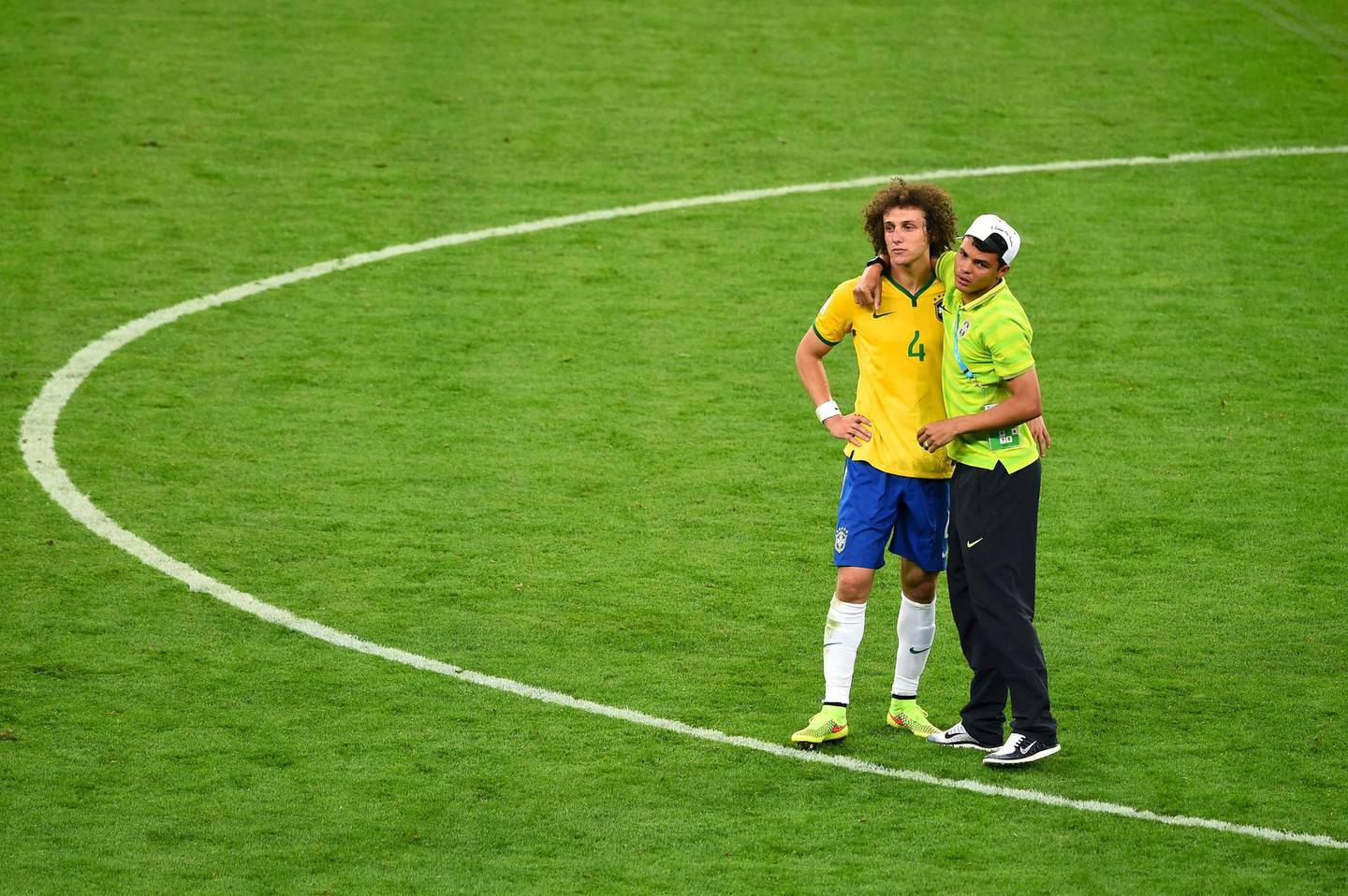 BELO HORIZONTE, BRAZIL - JULY 08:  Thiago Silva of Brazil consoles David Luiz after Germany's 7-1 victory during the 2014 FIFA World Cup Brazil Semi Final match between Brazil and Germany at Estadio Mineirao on July 8, 2014 in Belo Horizonte, Brazil.  (Photo by Jamie McDonald/Getty Images)