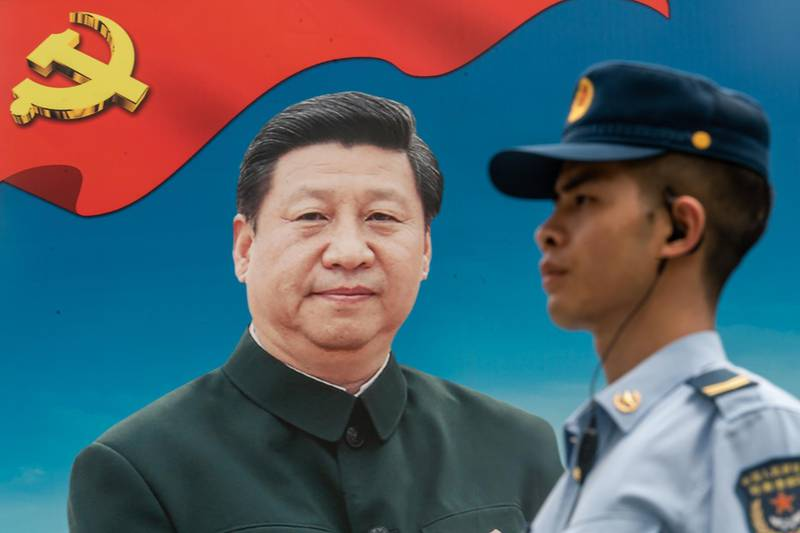 HONG KONG, HONG KONG - June 30: A member of the People's Liberation Army (PLA) stands guard in front of a billboard of Chinese President Xi Jinping at the Shek Kong Barracks on June 30, 2018 in Hong Kong, Hong Kong. Hong Kong will mark 21 years since its return to Chinese sovereignty from British rule on Sunday as thousands of people are expected to turn up for an annual rally to demand full democracy and vent their frustration over the soaring accommodation costs in the world's most expensive city for expatriates. (Photo by Anthony Kwan/Getty Images)