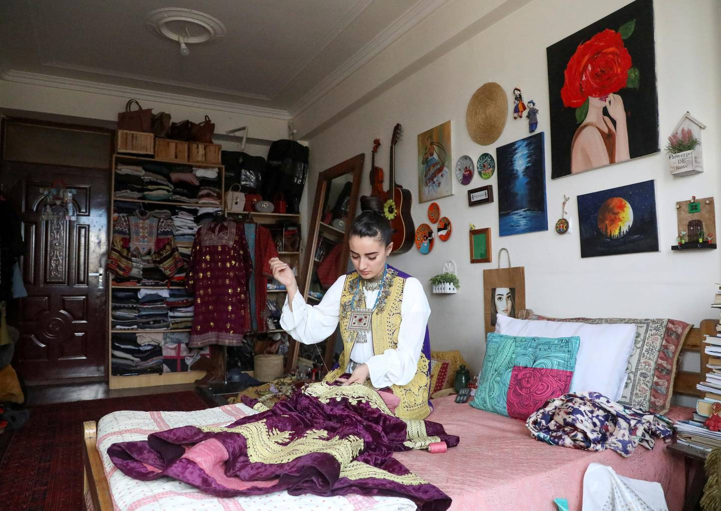 Maryam Yousufi, 25, sews a traditional Afghan design clothing at her home in Kabul, Afghanistan March 8, 2021. Picture taken March 8, 2021.  REUTERS/Omar Sobhani
