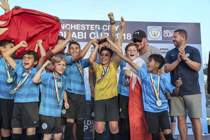 Abu Dhabi, March 24, 2018.  Manchester City Abu Dhabi Cup for juniors. Tekkers Blue team, from Bahrain celebrates after taking the U-10 win.Victor Besa / The NationalSportsReporter:  Amith Passela