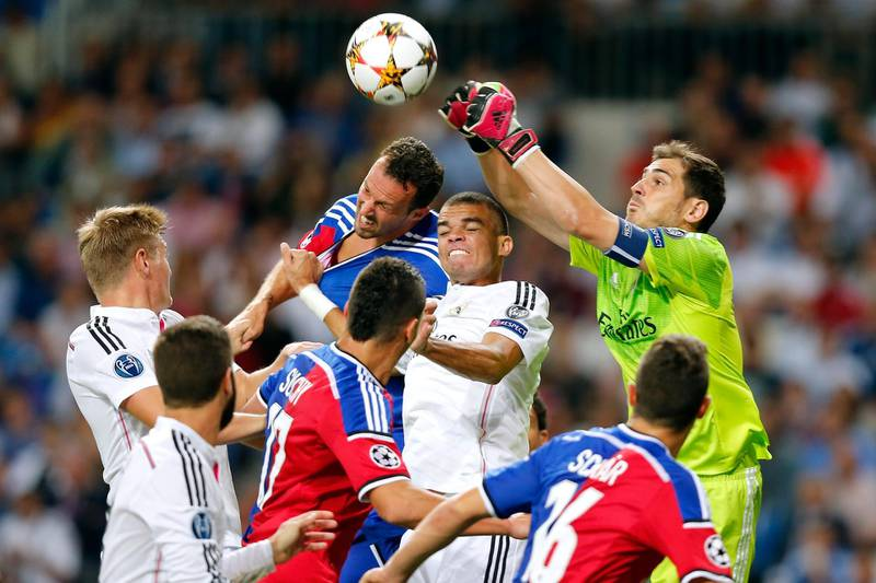 MADRID, SPAIN - SEPTEMBER 16: Iker Casillas (R) of Real Madrid clears the ball during the UEFA Champions League group B match between Real Madrid and FC Basel 1893 at Estadio Santiago Bernabeu on September 16, 2014 in Madrid, Spain. (Photo by Victor Carretero/Real Madrid via Getty Images)