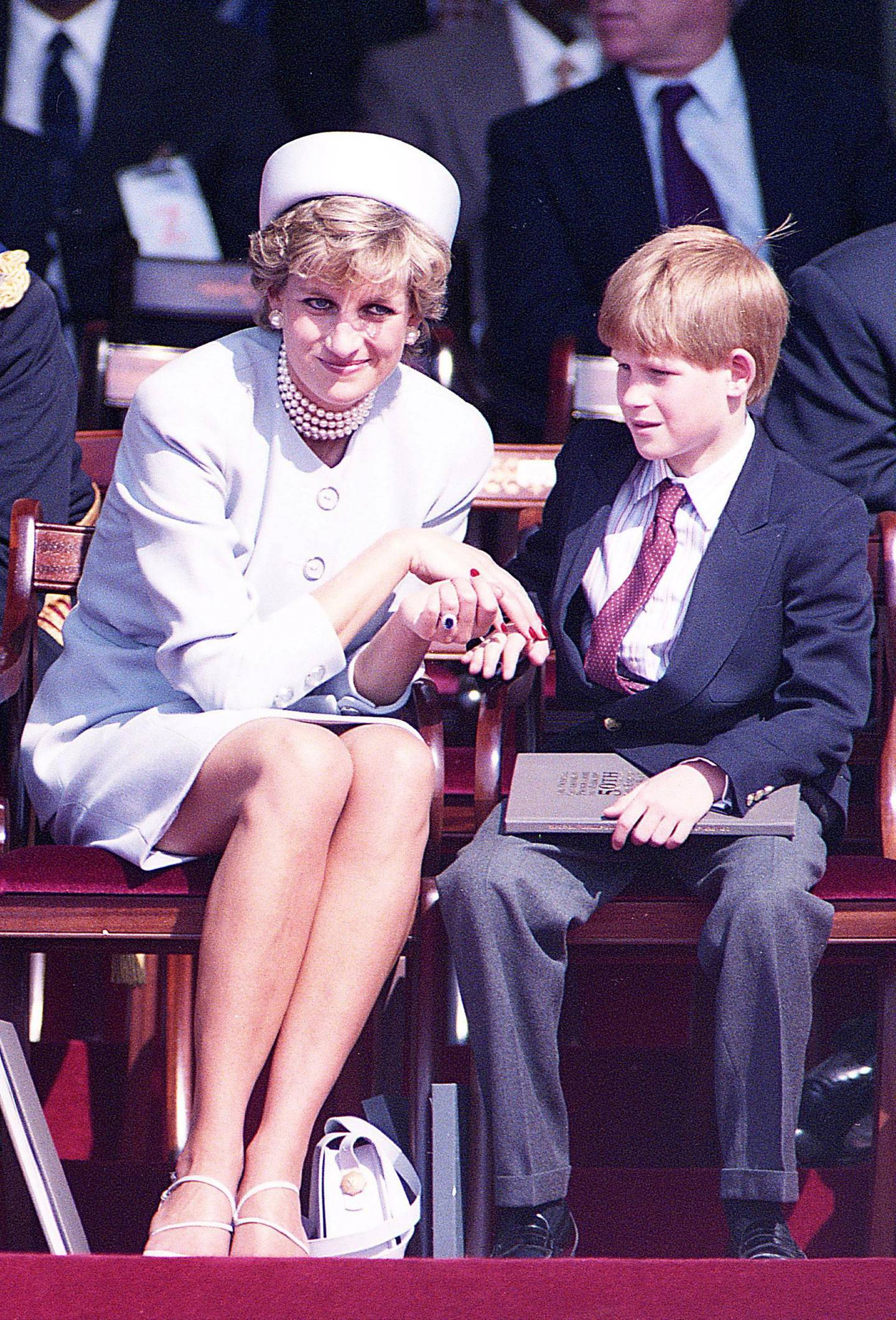 Britain's Princess Diana and son Prince Harry during a Heads of State Ceremony in Hyde Park, in London, Britain, May 7, 1995. Picture taken May 7, 1995  REUTERS/Dylan Martinez