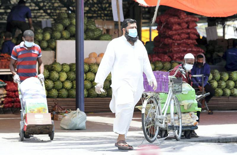 DUBAI, UNITED ARAB EMIRATES , June 9 – 2020 :- People wearing protective face mask and buying fruits and vegetables at the Al Awir fruit & vegetable market during the hot and humid weather in Dubai. (Pawan Singh / The National) For News/Standalone/Online/Stock