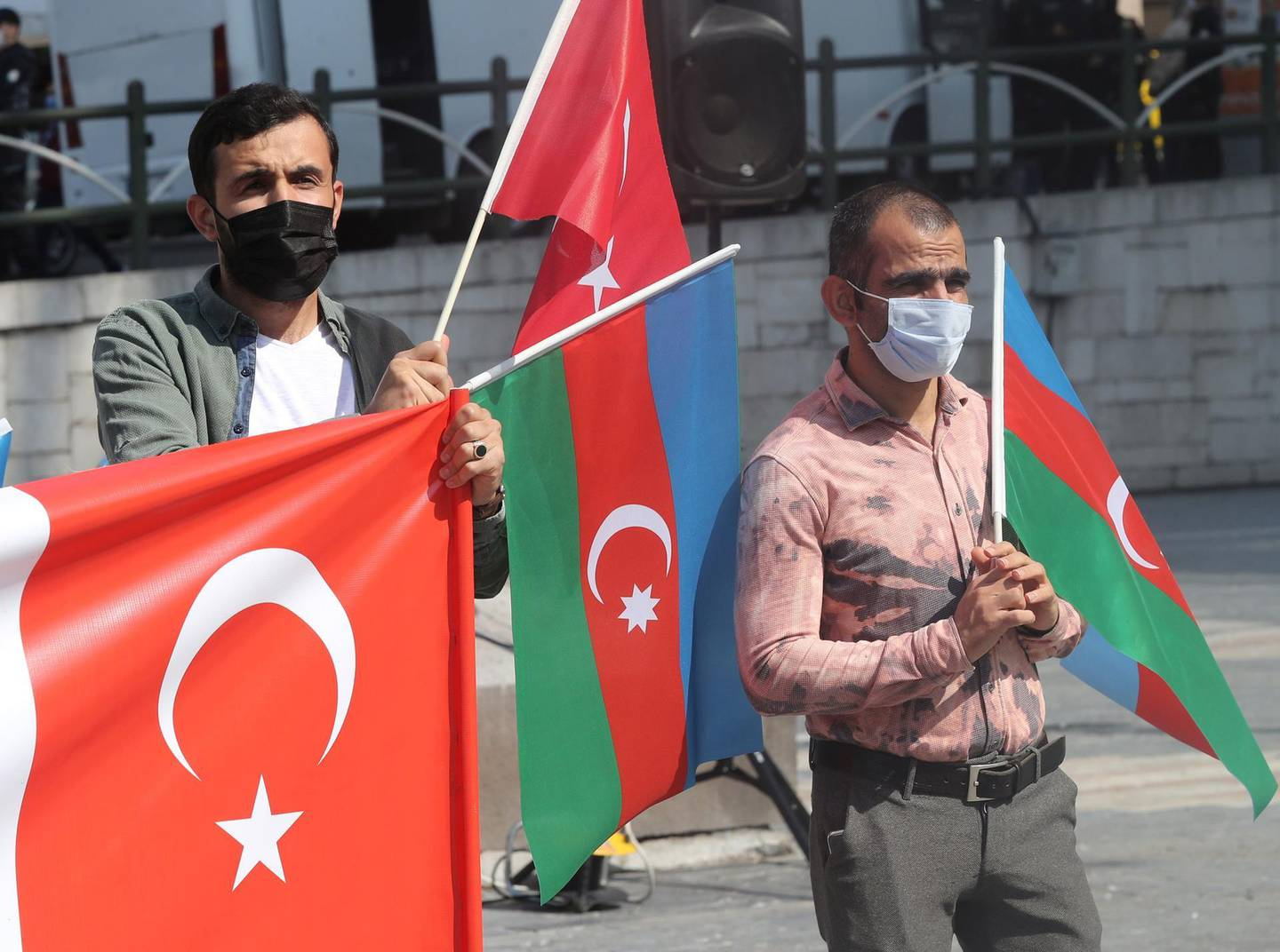 Turkish demonstrators participate in a demonstration in support of Azerbaijan against Armenia in Ankara on October 1, 2020.  Heavy shelling between Armenian and Azerbaijani forces persisted on October 1, 2020 despite fresh calls from world leaders for an end to days of fighting over the disputed Nagorny Karabakh region. The rival Caucasus nations have been locked in a bitter stalemate over the Karabakh region since the collapse of the Soviet Union when the ethnic Armenian province broke away from Azerbaijan. / AFP / Adem ALTAN