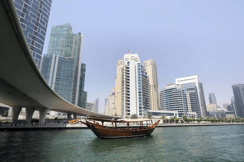A dhow goes under a bridge in the Marina, Dubai on May 12th, 2021. Chris Whiteoak / The National.  Reporter: N/A for News