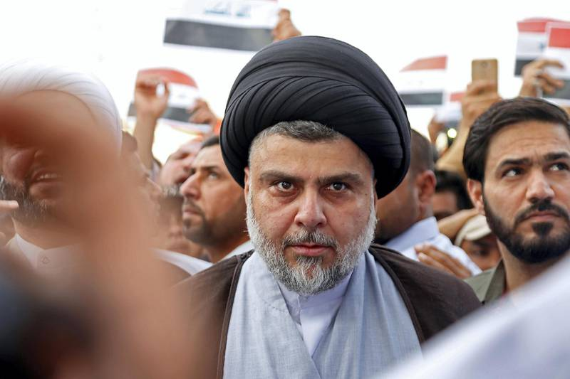 Shiite cleric Moqtada al-Sadr attends the demonstration against the western bombings of Syria, which he called for, on april 15, 2018, in Najaf. US, French and British missiles destroyed sites suspected of hosting chemical arms development and storage facilities but the buildings were mostly empty and the Western trio swiftly reverted to its diplomatic efforts. / AFP PHOTO / Haidar HAMDANI