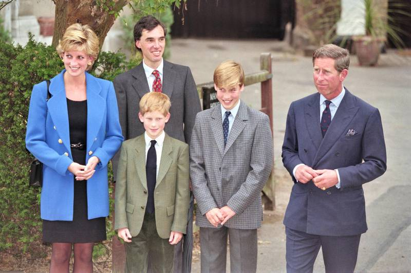 British Royal Diana, Princess of Wales (1961-1997), wearing a blue jacket over a black dress, with Eton housemaster Dr Andrew Gailey, Prince Harry, Prince William, and Prince Charles outside Manor House on Prince William's first day at Eton College in Eton, Berkshire, England, 16th September 1995. (Photo by Princess Diana Archive/Hulton Archive/Getty Images)