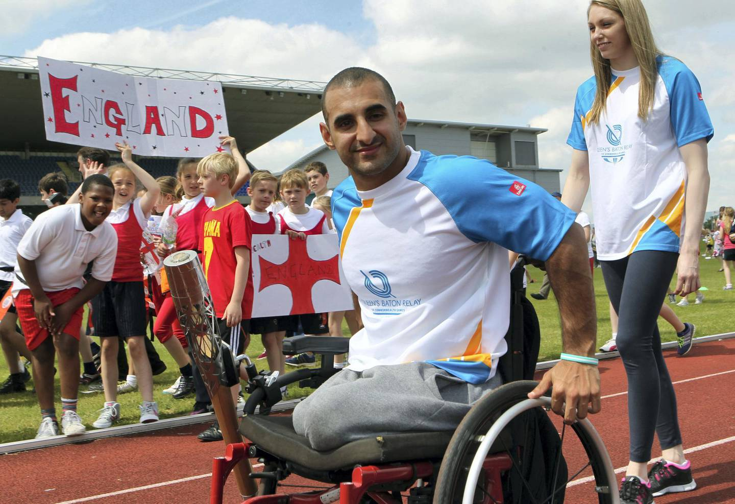 LEEDS, ENGLAND - JUNE 12:   (EDITORIAL USE ONLY, NO SALES)  In this handout image provided by Glasgow 2014 Ltd, Baton bearer Ali Jawad carries the Queen's Baton at the John Charles Centre for Sport on June 12, 2014 in Leeds, England.  England is nation 69 of 70 nations and territories the Queen's Baton will visit. (Photo by David Cheskin/Glasgow 2014 Ltd via Getty Images)