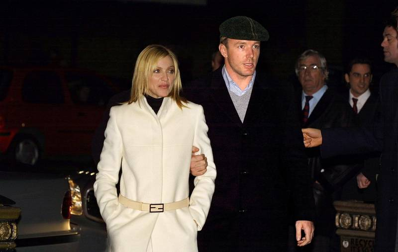 398820 08: Singer Madonna and husband, film director Guy Ritchie arrive for the World Premiere of the film ''Mean Machine'' December 18, 2001 at the Kensington Odeon cinema in London. The film stars British ex-soccer player Vinnie Jones and is executive produced by Guy Ritchie. (Photo by Sion Touhig/Getty Images)