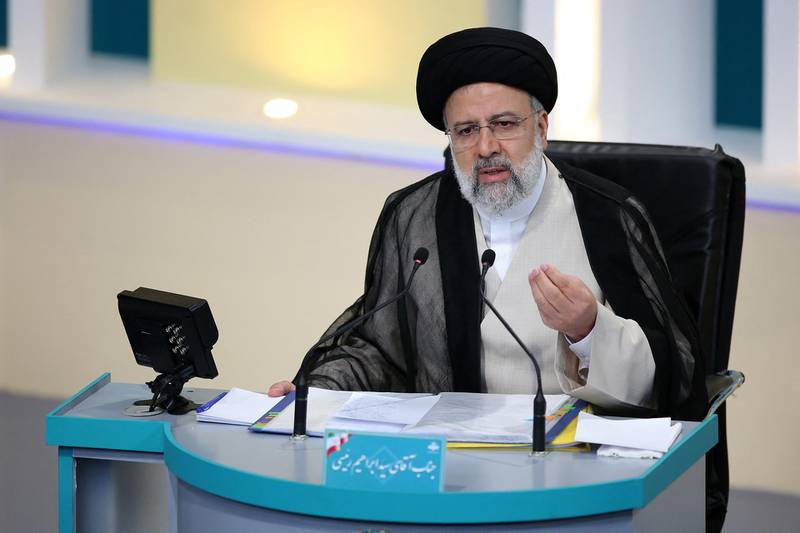 """This handout photo made available by the Iranian Young Journalist Club (YJC) shows Iran's presidential candidate Ebrahim Raisi during the second televised debate ahead of the June 18 election, at the Iran State television studio in Tehran on June 8, 2021.  - RESTRICTED TO EDITORIAL USE - MANDATORY CREDIT """"AFP PHOTO /IRANIAN YOUNG JOURNALIST CLUB (YJC)  """" - NO MARKETING - NO ADVERTISING CAMPAIGNS - DISTRIBUTED AS A SERVICE TO CLIENTS  / AFP / YJC NEWS AGENCY  / MORTEZA FAKHRI NEZHAD / RESTRICTED TO EDITORIAL USE - MANDATORY CREDIT """"AFP PHOTO /IRANIAN YOUNG JOURNALIST CLUB (YJC)  """" - NO MARKETING - NO ADVERTISING CAMPAIGNS - DISTRIBUTED AS A SERVICE TO CLIENTS"""