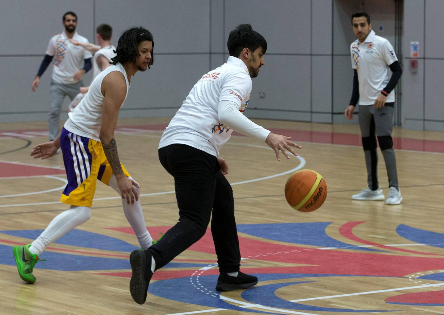 SHEFFIELD,UNITED KINGDOM. 19th January 2019. Members of a UAE Embassy delegation from London, take part in a game of basketball with athletes from the  Special Olympics-GB Team , during a visit to a training camp in Sheffield, United Kingdom, ahead of the Special Olympics World Games 2019 in Abu Dhabi. Stephen Lock for the National