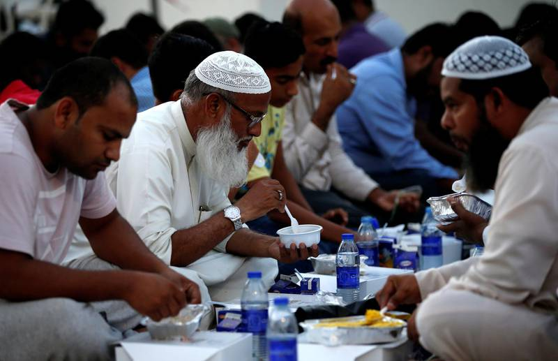 epa06759065 Muslims break their fast after sunset during the Islamic Holy month of Ramadan, in Dubai, United Arab Emirates, 23 May 2018 (Issued 24 May 2018). Muslims around the world celebrate the holy month of Ramadan by praying during the night time and abstaining from eating, drinking, and sexual acts during the period between sunrise and sunset. Ramadan is the ninth month in the Islamic calendar and it is believed that the revelation of the first verse in Koran was during its last 10 nights.  EPA/ALI HAIDER