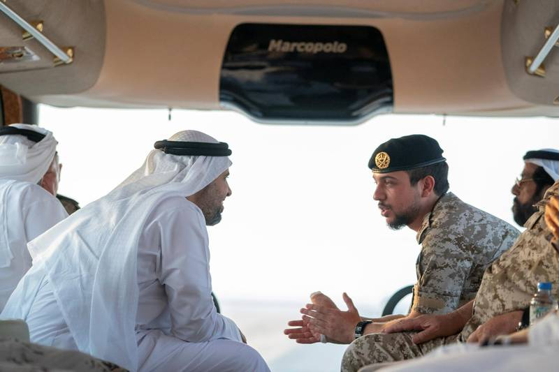 AL DHAFRA REGION, ABU DHABI, UNITED ARAB EMIRATES - June 26, 2019: HH Sheikh Theyab bin Mohamed bin Zayed Al Nahyan, Chairman of the Department of Transport, and Abu Dhabi Executive Council Member (L) and HRH Hussein bin Abdullah, Crown Prince of Jordan (R), inspect military exercise sites during the UAE and Jordan joint military drill, Titled 'Bonds of Strength', at Al Hamra Camp.  ( Mohamed Al Hammadi / Ministry of Presidential Affairs ) ---